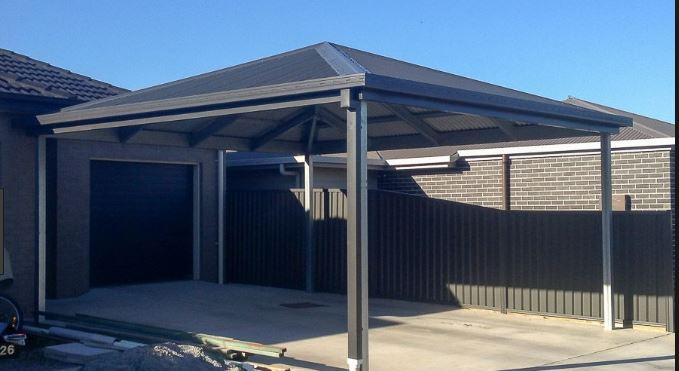 Open on all sides carport in a black colorbond material
